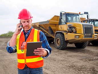 Construction-man-with-tablet-and-phone-2.png